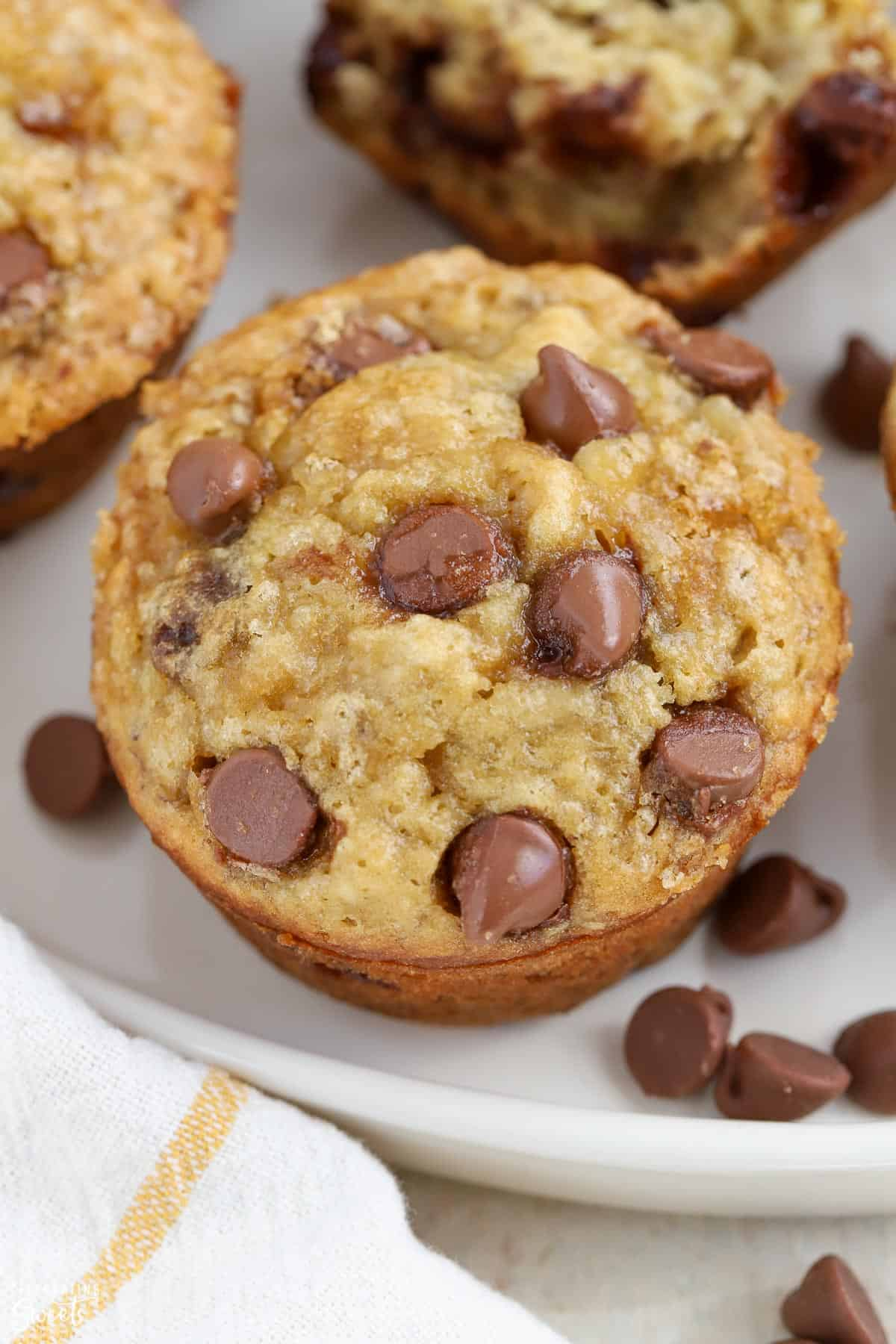 Close up of Banana Chocolate Chip Muffin on a white plate