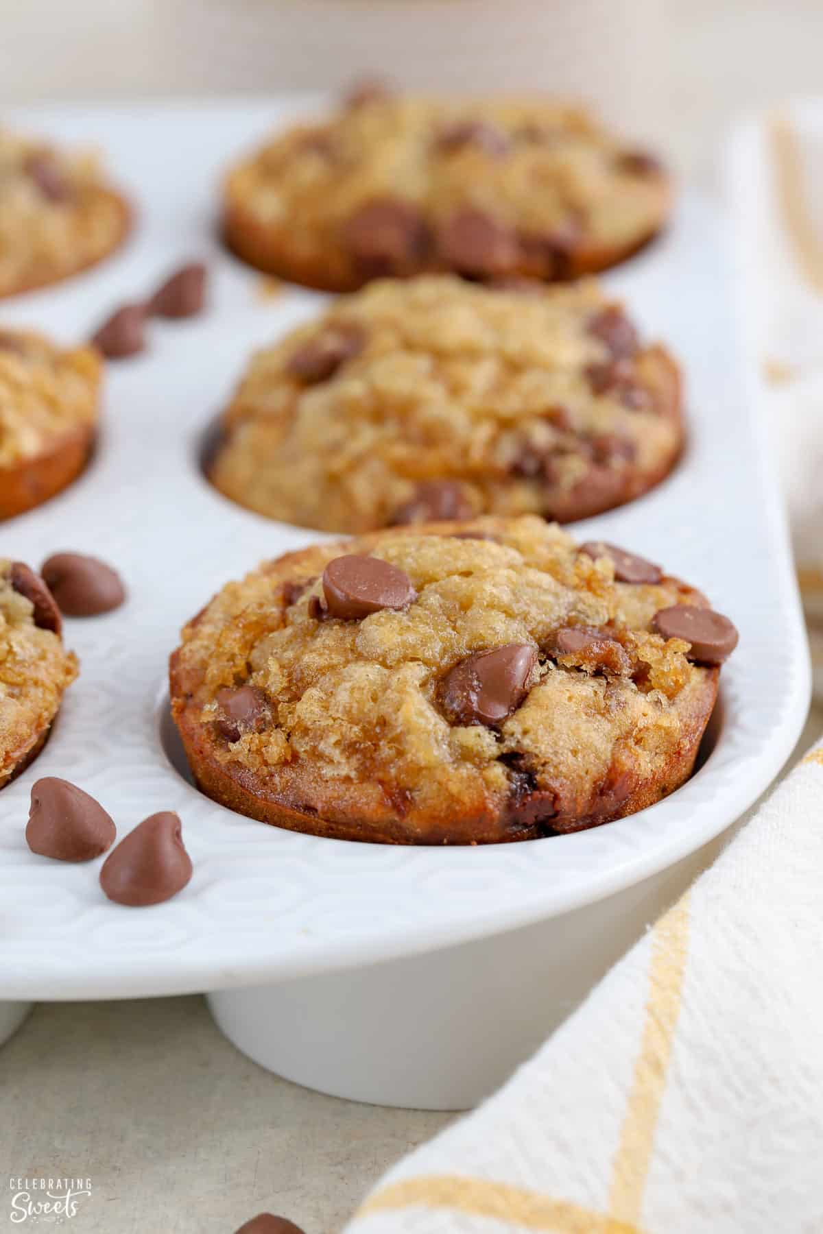 Banana Chocolate Chip Muffins in a white muffin pan