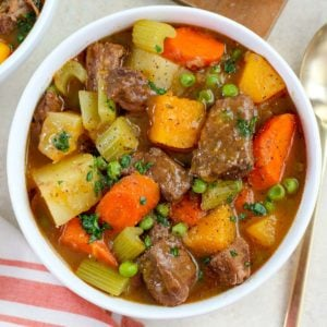Beef stew and vegetables in a white bowl