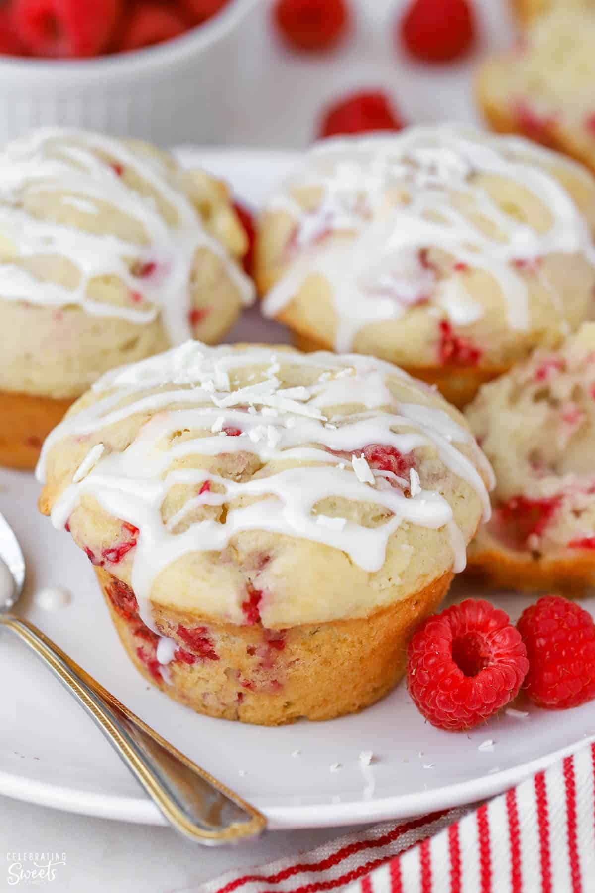 Closeup of raspberry muffins drizzled with icing.