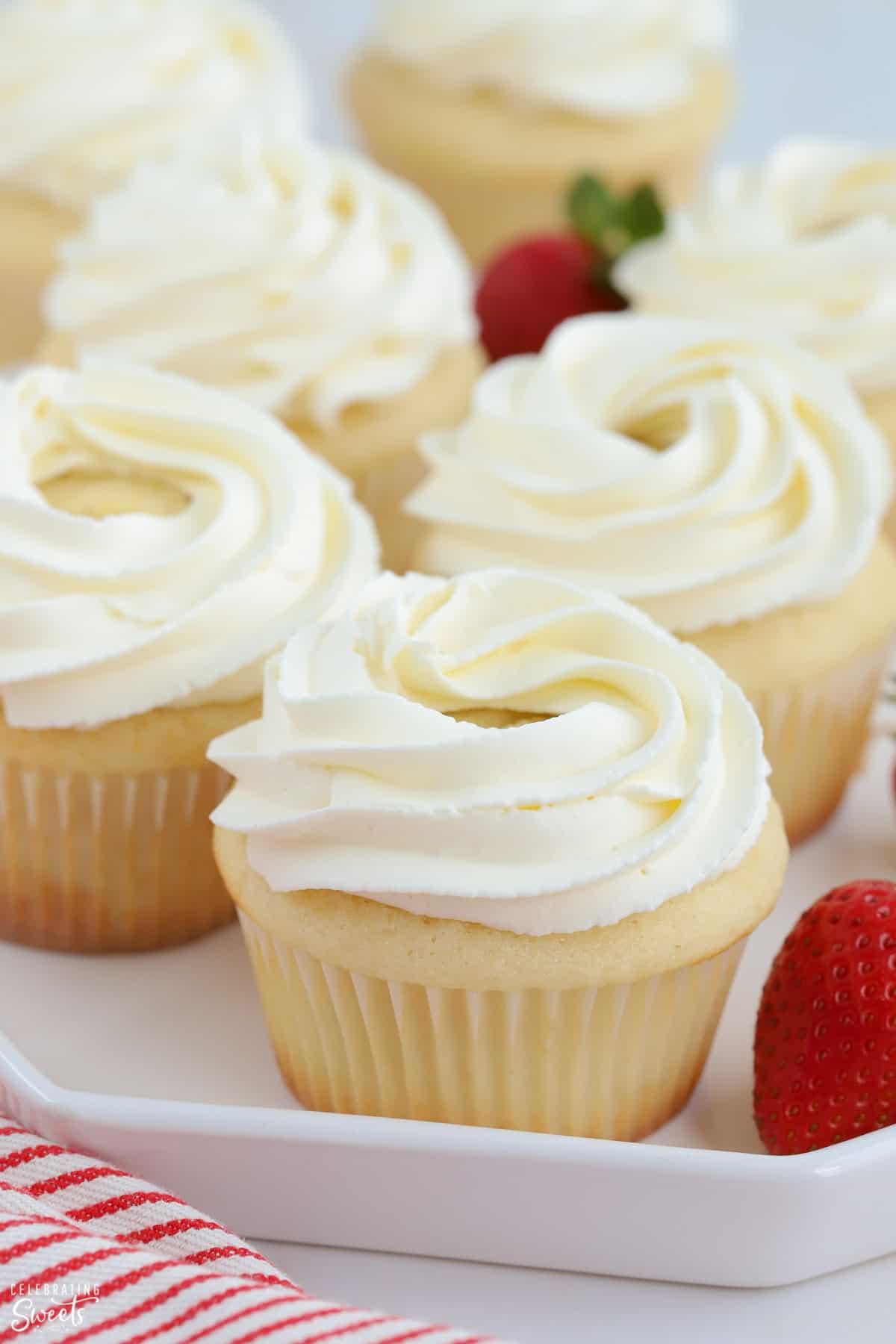 Closeup of vanilla cupcake with swirled white frosting