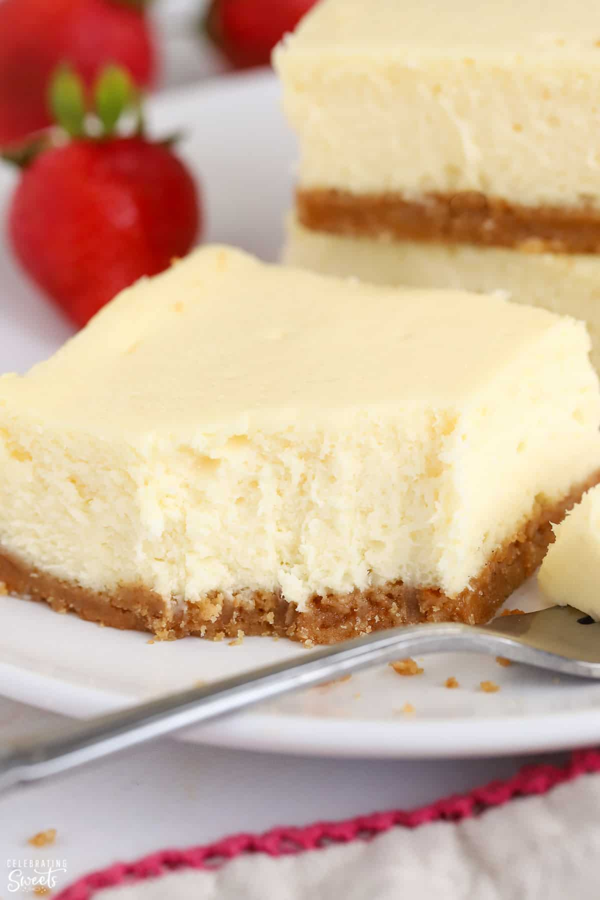 Cheesecake bar on a white plate with a fork