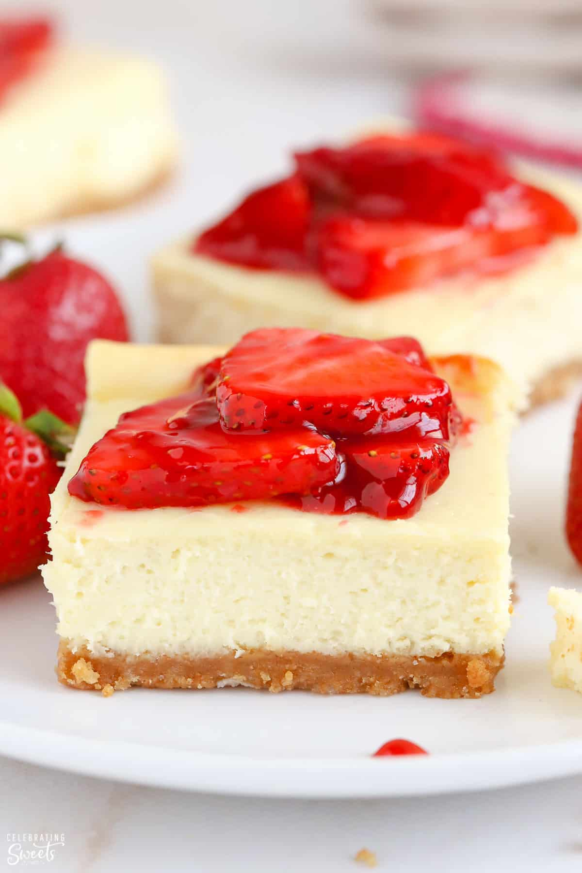 Cheesecake bar topped with strawberries