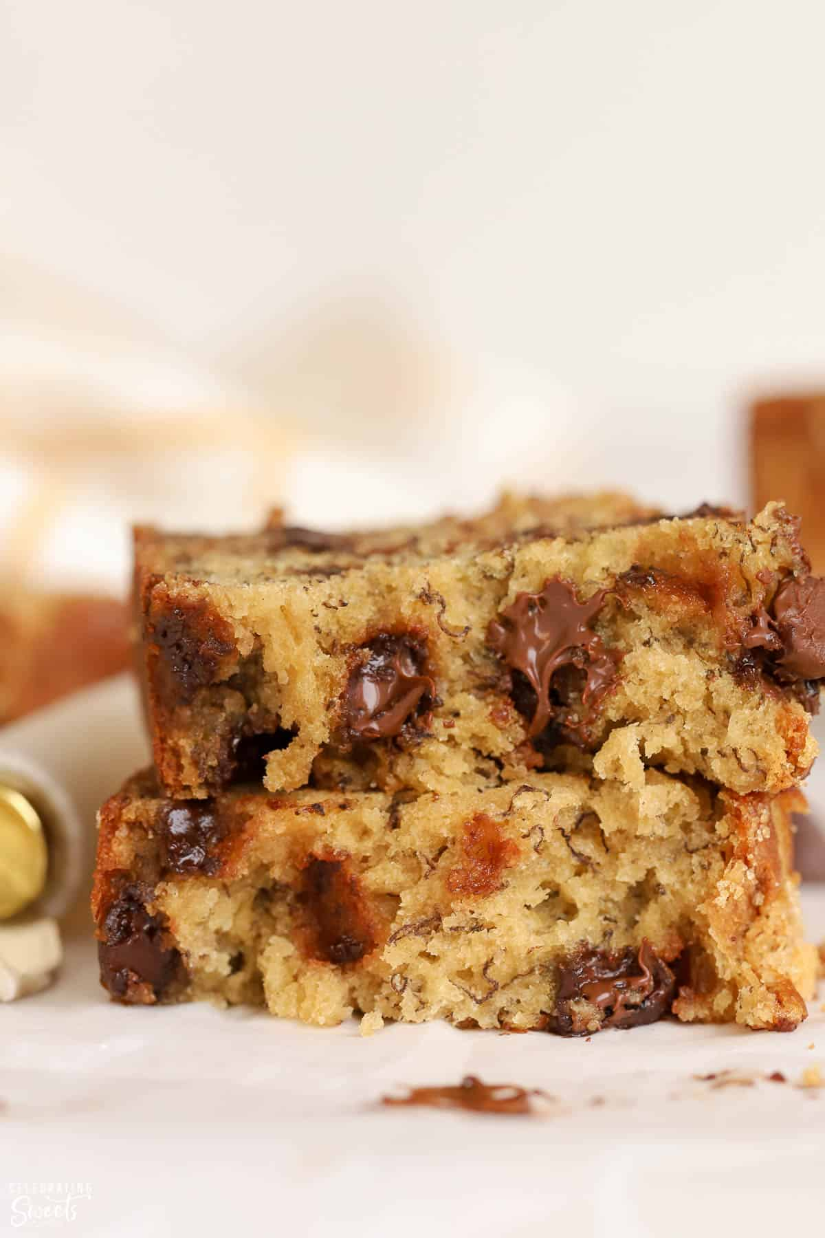 Closeup of a slice of banana bread filled with chocolate chips.
