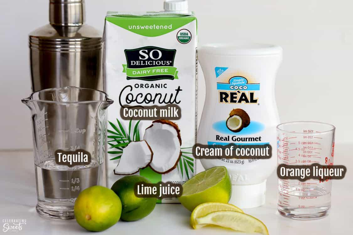 Ingredients for making coconut margaritas (tequila, triple sec, limes, coconut milk)