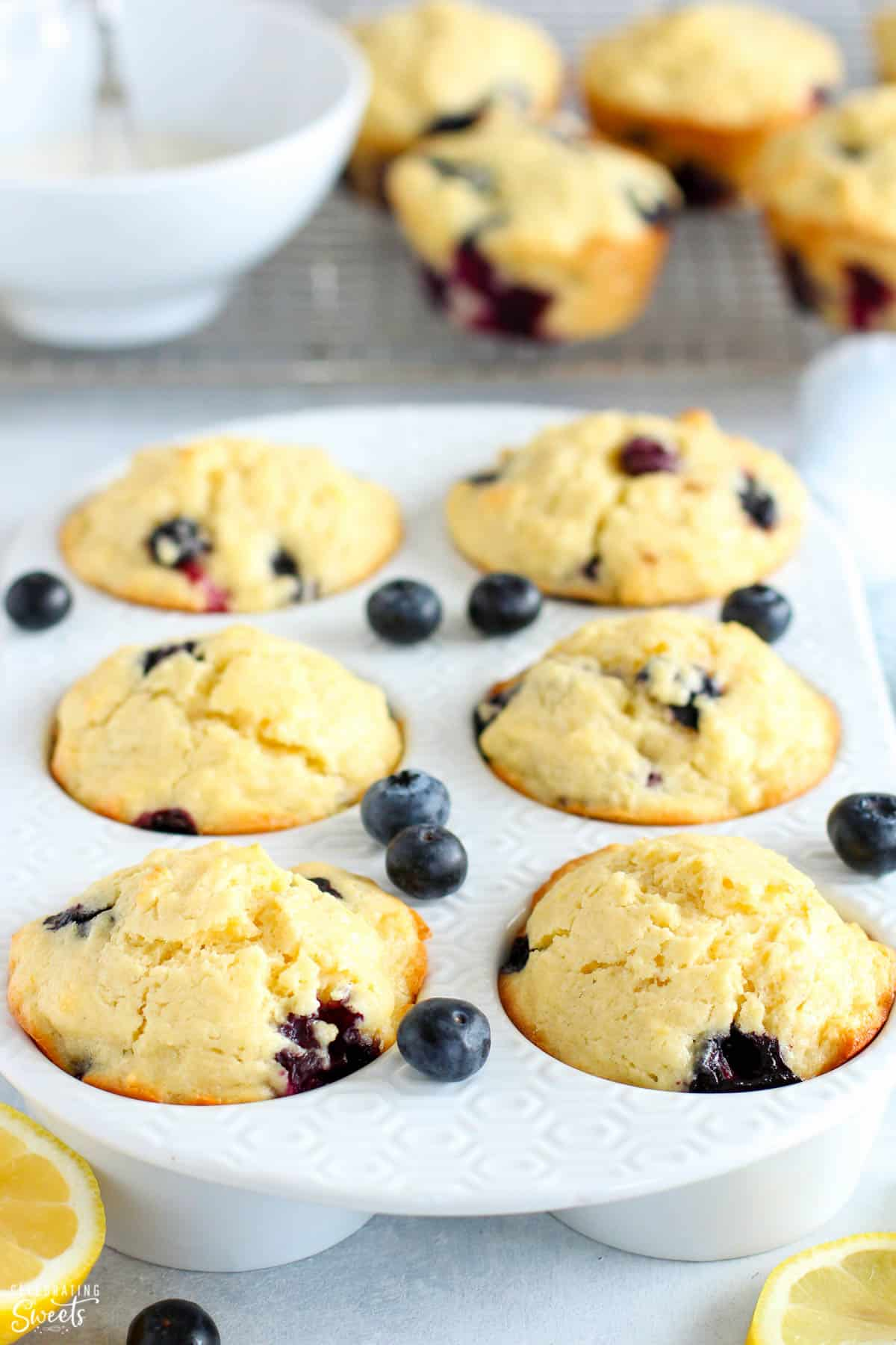Lemon Blueberry Muffins in a white muffin pan.