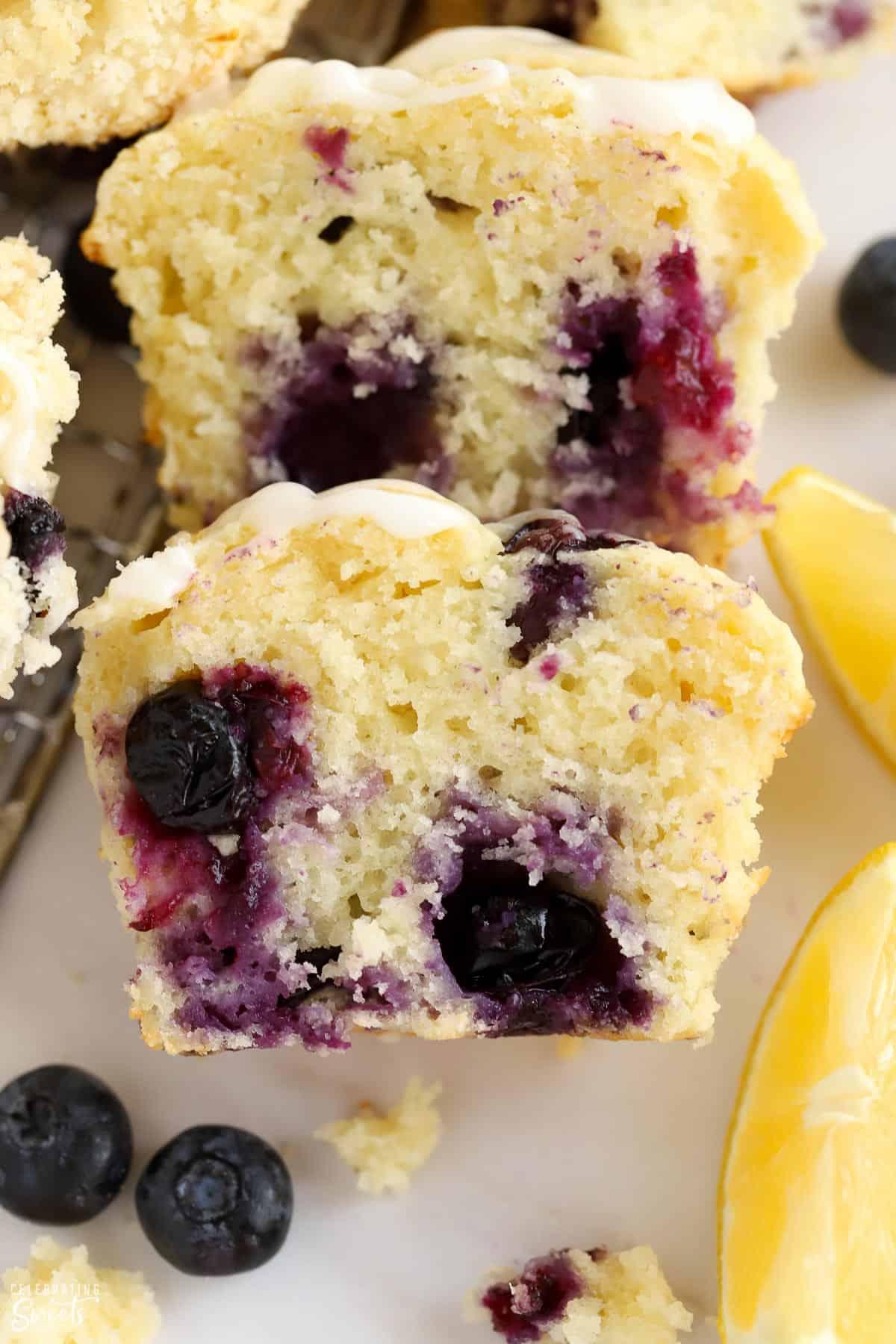 Closeup of a lemon blueberry muffin cut in half.