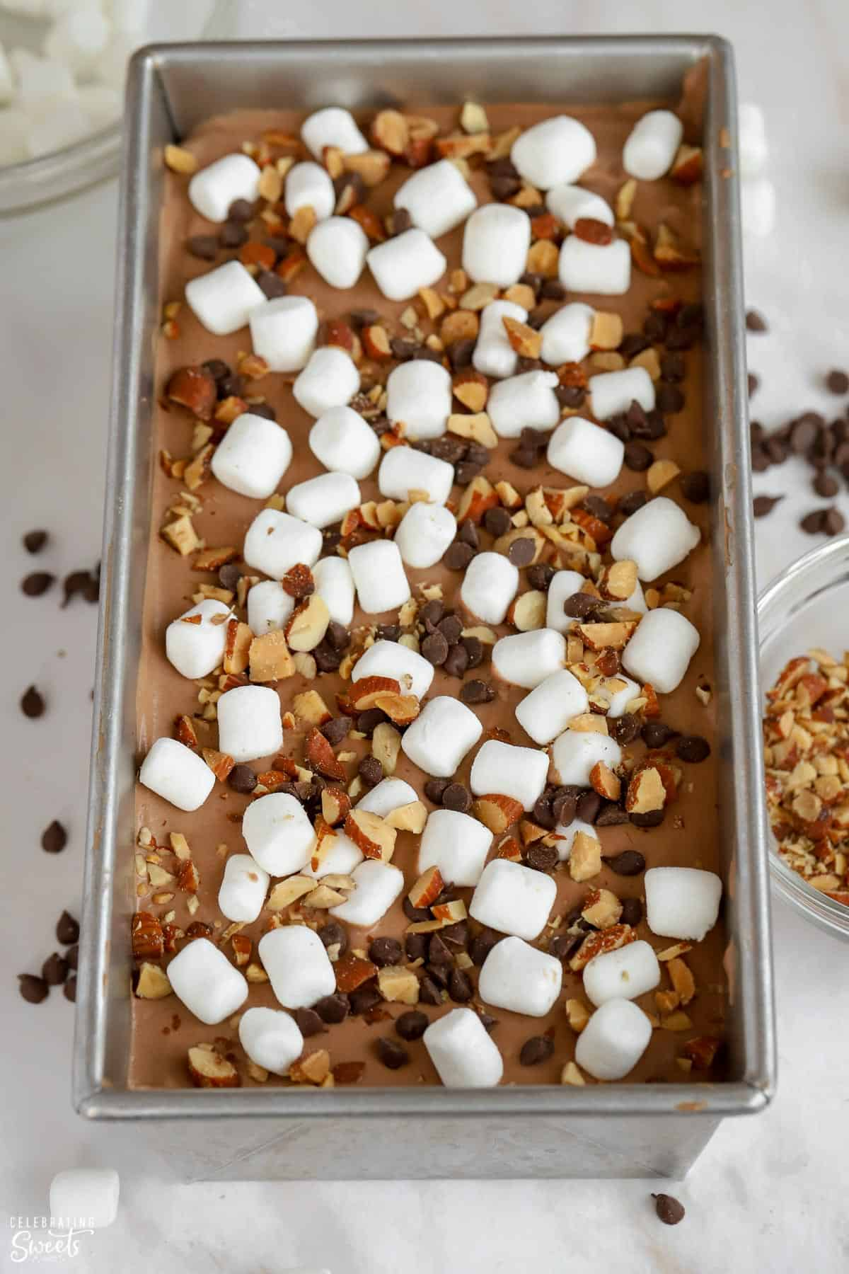 Rocky road ice cream in a loaf pan.