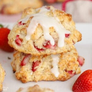 Two strawberry biscuits stacked on top of each other.