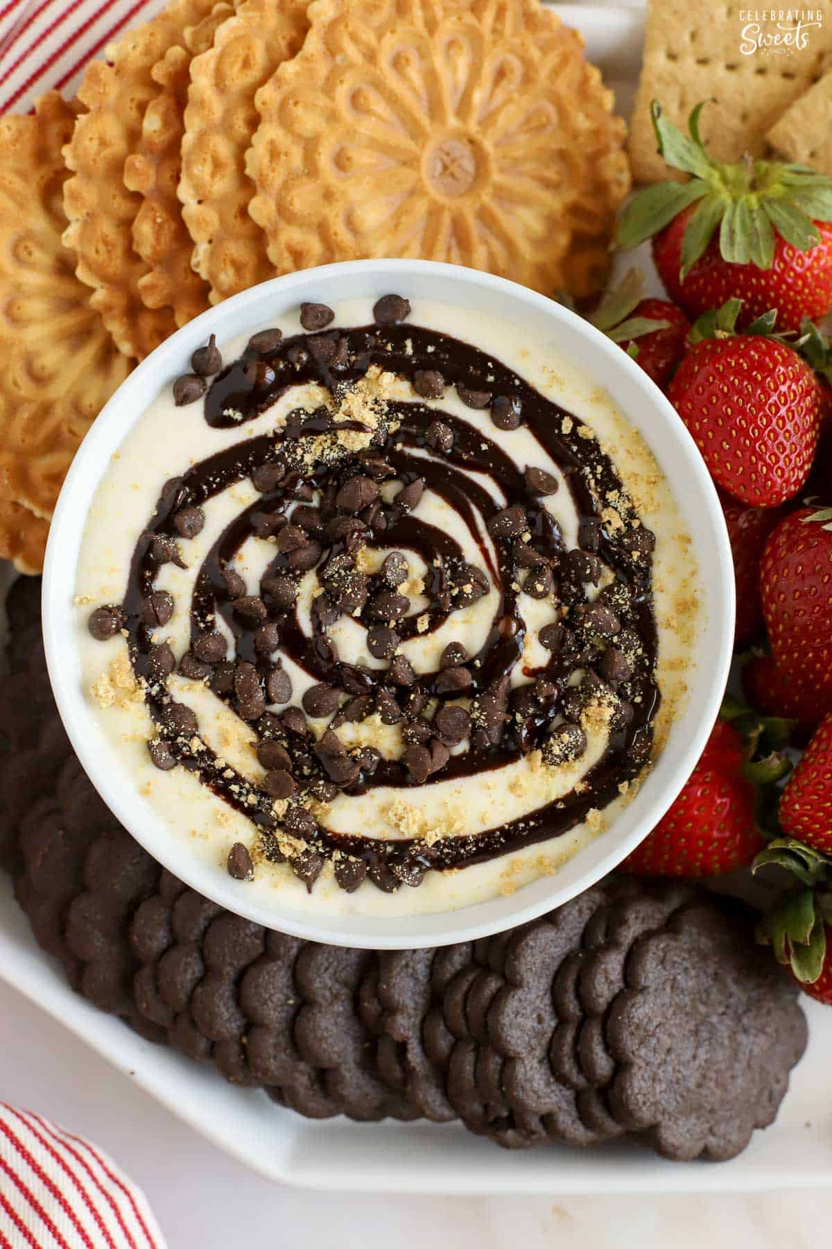 Cheesecake dip topped with chocolate swirls and chocolate chips