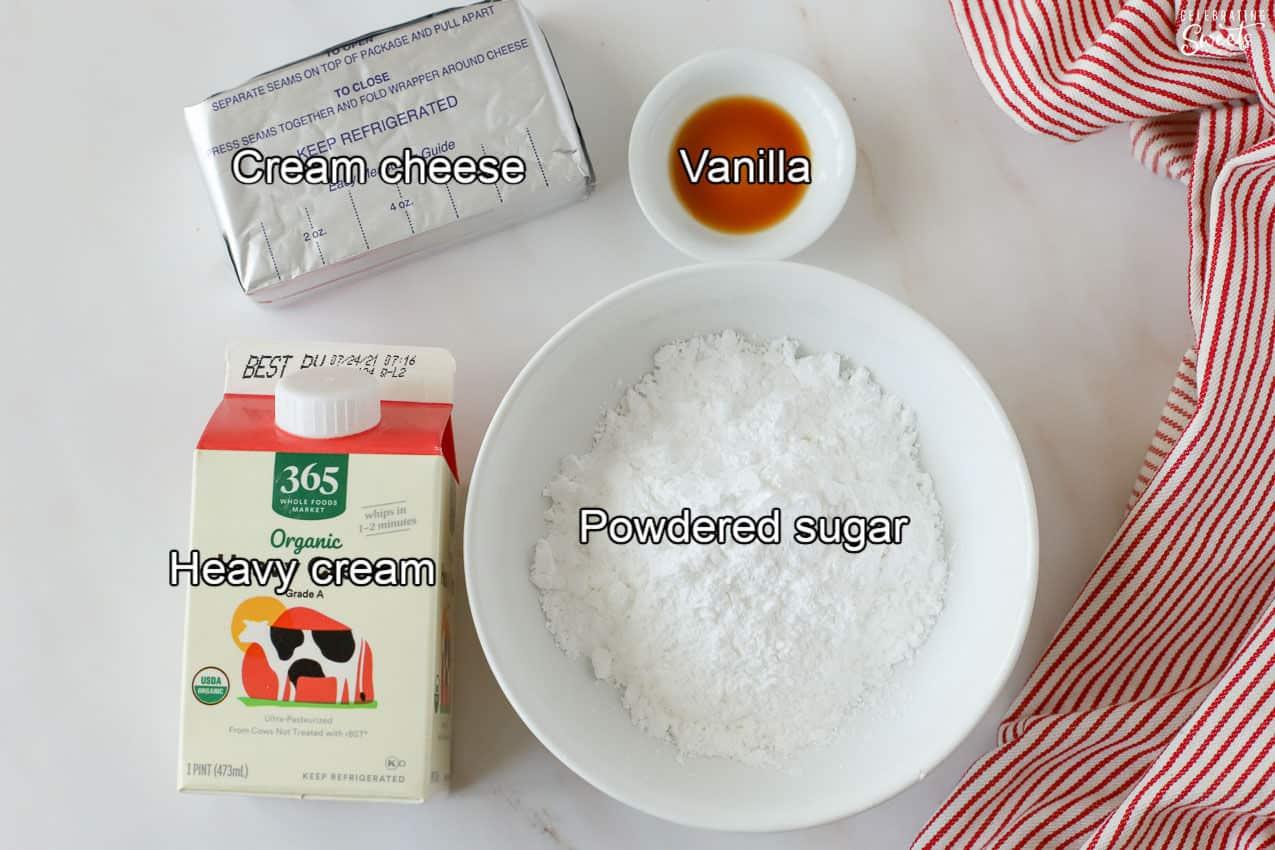 Ingredients for cheesecake dip (cream cheese, cream, powdered sugar, vanilla)