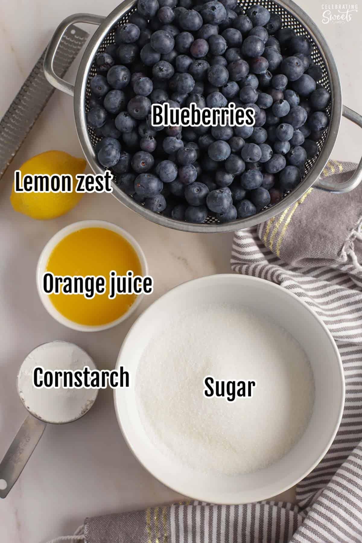Ingredients for blueberry pie filling: blueberries, cornstarch, juice, sugar, lemon.