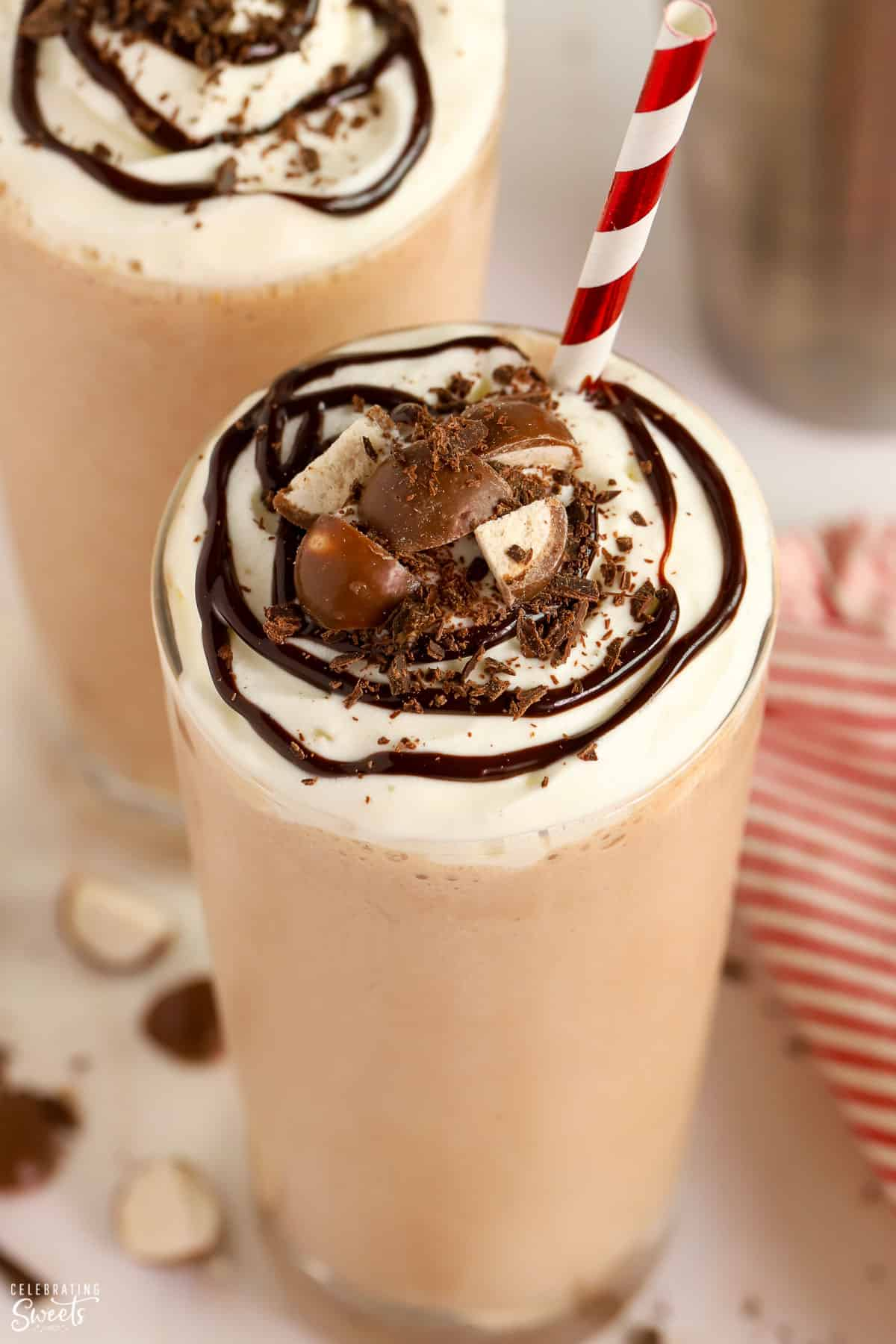 Closeup of chocolate malt topped with whipped cream and chocolate sauce.