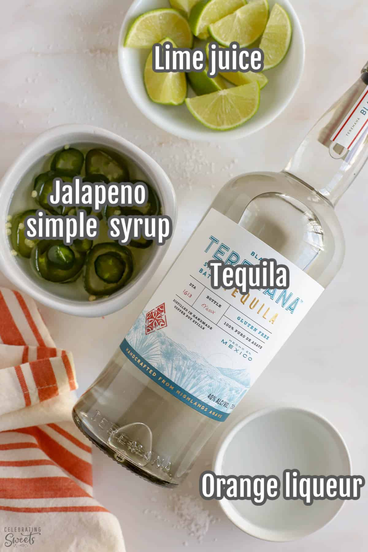 Ingredients for a spicy margarita: tequila, liqueur, limes, jalapeno syrup.