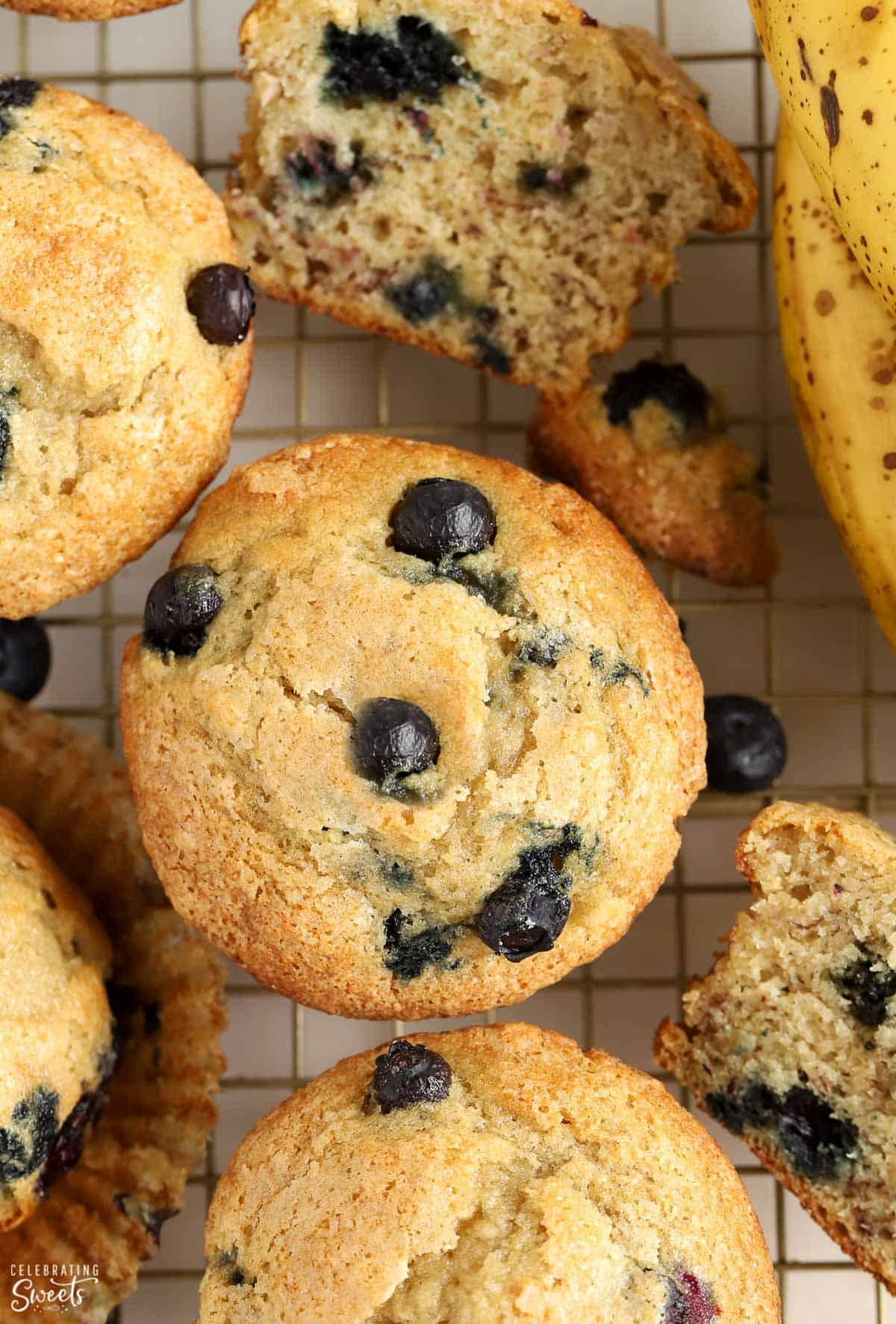 Overhead shot of blueberry banana muffins on a wire rack.