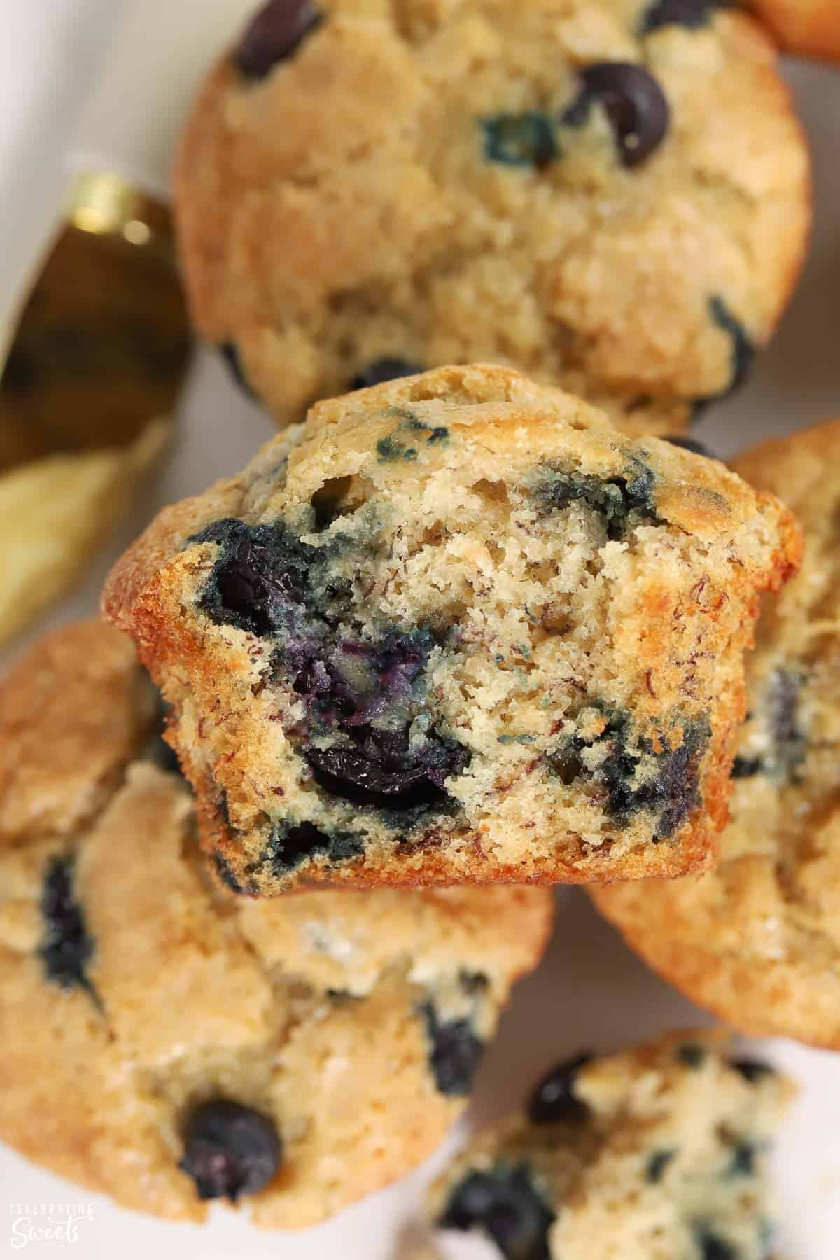 Closeup of blueberry banana muffin with a bite taken out of it.
