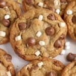 Closeup of s'mores cookies topped with chocolate chips and marshmallows