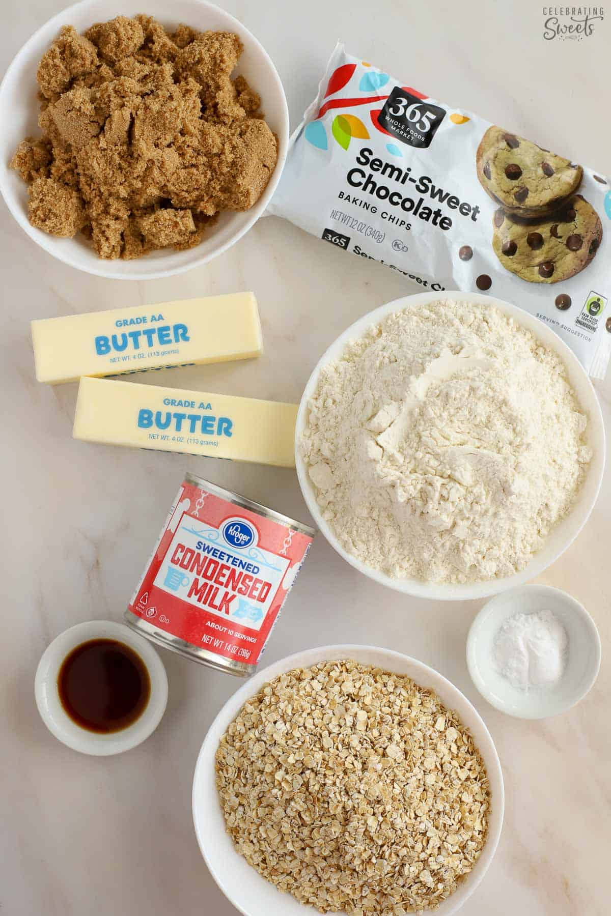Ingredients for Oatmeal Fudge Bars - Oats, flour, brown sugar, condensed milk, chocolate chips, butter, vanilla.