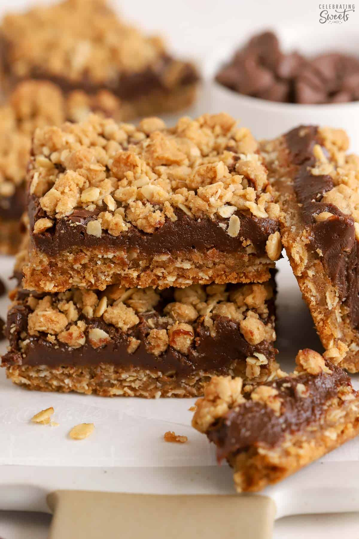 Stack of three Oatmeal Fudge Bars on parchment paper.