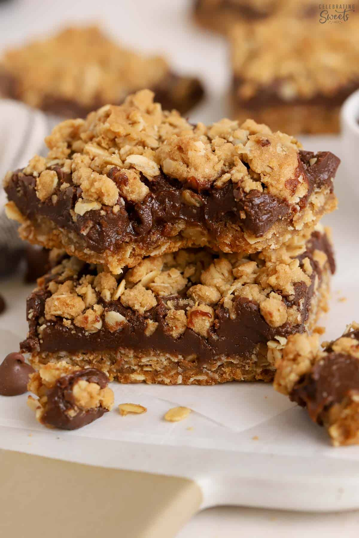 Stack of two Oatmeal Fudge Bars on parchment paper.